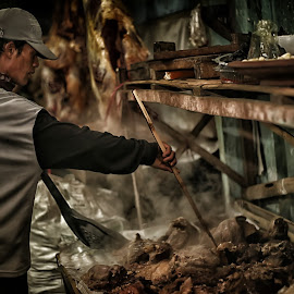 traditional meat processing by Jhon Welly - People Portraits of Men
