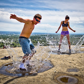 In a Moment by Will Ballew - People Couples ( water, splash, summer, puddle, sunglasses )