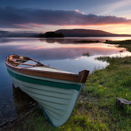 The Boat by Michal Tercjak - Transportation Boats ( water, clouds, connemara, ireland, colorful, grass, green, lake, boat, blue sky, dawn, color, sunrise )