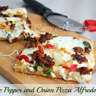 Sausage, Pepper, Onion and Spinach Alfredo Pizza