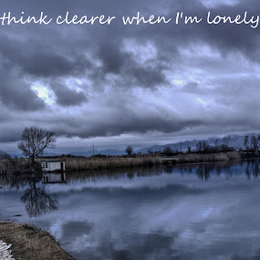 Loneliness by Stratos Lales - Typography Quotes & Sentences ( clouds, water, reflection, sky, loneliness )