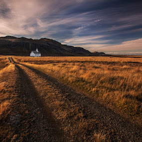 Narrow is the Way... by Bragi Ingibergsson - Buildings & Architecture Places of Worship ( clouds, mountain, church, grass, brin, bragi j. ingibergsson, road, rural, religion, iceland, sky, autumn, path )