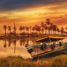 The Last Boat  by Ehab Monther - Transportation Boats ( clouds, water, sky, sunset, landscape, boat )