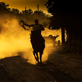 riding at sunset by Razvan Teodoreanu - People Portraits of Men