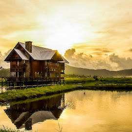 Sunset at a dream house by Jee Cornelius - Landscapes Sunsets & Sunrises ( clouds, reflection, sky, sunset, indonesia, tondano, house, place )