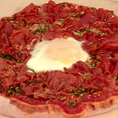 Pizza with Prosciutto, Spinach, Truffle Oil, and Egg