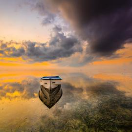 white boat by Wisnu Taranninggrat - Landscapes Cloud Formations