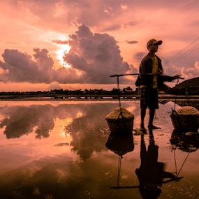 salt farmer by Arik S. Mintorogo - People Portraits of Men ( men ; water ; landscape ; salt ; field ; sun ; afternoon )