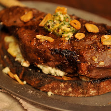 Broiled Spicy Steak with Garlic Chips on Gorgonzola Crostini