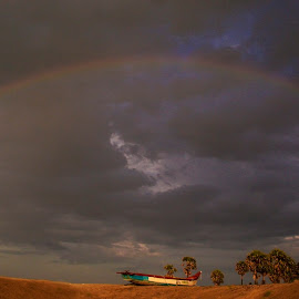 Alone by Mahul Mukherjee - Landscapes Cloud Formations ( clouds, colour, trees, boat, rainbow, photo )
