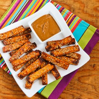 Baked Sesame Tofu Sticks with Peanut Butter, Tahini, and Ginger Sauce