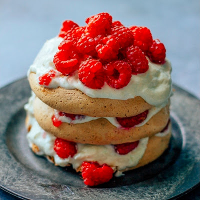Dark Chocolate Pavlovas with Raspberries & Cream