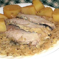 Slow Cooker German-Style Pork Roast with Sauerkraut and Potatoes