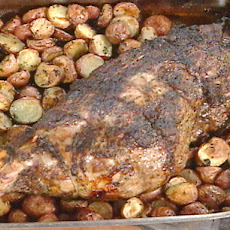 Herb-Encrusted Roast Leg of Lamb with Garlic Roasted Baby Potatoes
