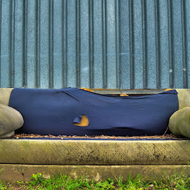 An old couch by Adrian Berghorst - Artistic Objects Furniture ( old, grass, blue, couch., factory, steel )