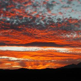 Sunset on the Front Range by Steven Kirwan - Landscapes Sunsets & Sunrises ( cloud formations, clouds, orange, mountains, sunset, colorado )