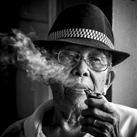 A cigar is as good as memories that you have when you smoked it - Raul Julia by Andrew Micheal - People Portraits of Men ( smoke, cigarettes, people )