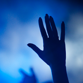 Hand of fan silhouetted against blue smoke by Nick Dale - People Musicians & Entertainers ( concert, blue, hands, fans, silhouette, turkey, iphone, bodrum, smoke, gig )