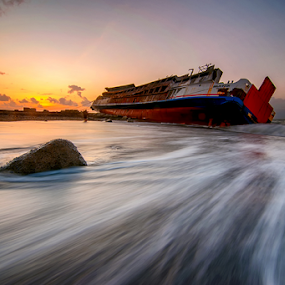 Abandoned by Hendri Suhandi - Landscapes Sunsets & Sunrises ( bali, shipwreck, wave, sunrise, beach, travel, motion, abandoned )