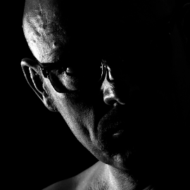 Out of the dark by Axel K. Böttcher - People Portraits of Men ( b&w, square, man, portrait )