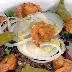 A Creole Fried Shrimp Salad with Vidalia Onions, a Classic Remoulade Dressing and Pickled Okra