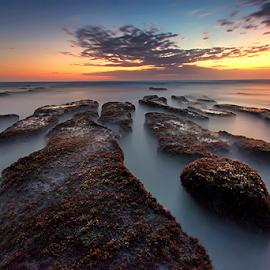 Sunset at Nyanyi Beach by Yudik Pradnyana - Landscapes Sunsets & Sunrises ( clouds, bali, sunset, long exposure, rock formation, landscapes, sun )