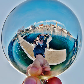 Lindau´s in my Hand! by Jesus Giraldo - Abstract Fine Art ( hand, urban, reflection, concept, harbour, art, christmas ball, beauty, city )