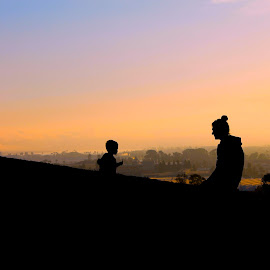 Mother and Son by Wendy Smith  - People Family ( love, mother, silhouette, sunset, son )