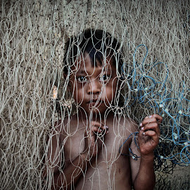 Inside the nets by Deddy Dee - People Portraits of Men ( children )