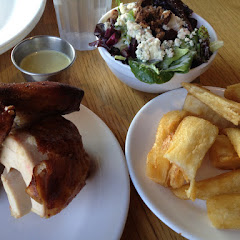 Dry rub roasted chicken, fried yucca and salad with candied pecans, blue cheese and bu