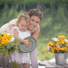 Family by Robert Moores - People Family ( little girl, family, woman, outdoors, kids, flowers, river )