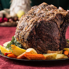 Herb-Crusted Beef Rib Roast with Potatoes, Carrots, and Pinot Noir Jus