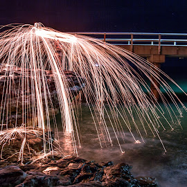 Spark shower by Leon Chester - Abstract Fire & Fireworks ( water, pier, night, jetty, abstract photography, sparks, night shot, rocks )