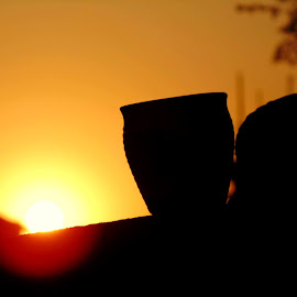 At an Evening Tea by Abhisek Joardar - Artistic Objects Cups, Plates & Utensils ( cup, abstract, cups, sunsets, sunset, artistic, artistic object, abstract photography, artistic objects, evening )