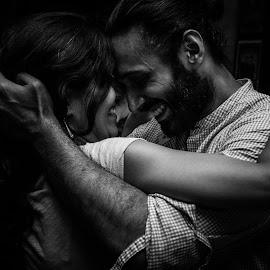 Dancing couple by Sooraj Sundararajan - People Street & Candids ( dancing, low key, black and white, couple, close up )