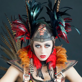 Pippin by Alistair Cowin - People Fashion ( theatrical costume, feather headress, high fashion, blue eyed girl, beautiful girl )