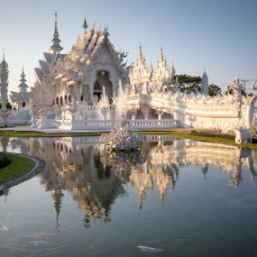 White Temple by Phil Hanna - Buildings & Architecture Places of Worship ( water, statue, sky, chiang rai, blue, fish, sunset, white temple, thailand, reflections )
