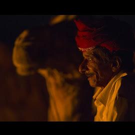 Everyone needs a good camel. by James L. Neihouse - People Portraits of Men ( socotra, yemen, camel, bedouin, firelight, campfire )