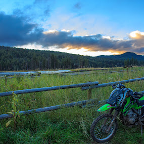 Kawasaki at Home by Devin Rieger - Transportation Motorcycles ( fence, nature, camping, grass, dirtbike, plants, campground, motorcycle, forest, lake, landscape,  )