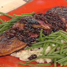 Seared Magret Duck Breast with Creamy Garlic Mashed Potatoes, Haricots Verts and Brandied Cherry Reduction Sauce