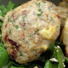 Chicken Tomato and Feta Patties on a Spinach Salad