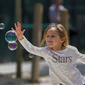 About to touch by Nuwan Ferdinand - Babies & Children Children Candids ( playing, girl, joy, street, bubbles, children, candid, soap )