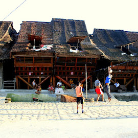 Traditional Village and Houses in Nias by Leong Jeam Wong - Sports & Fitness Other Sports ( roof, timber, village, children, traditional, house, attap, net, log, nias, volley ball )