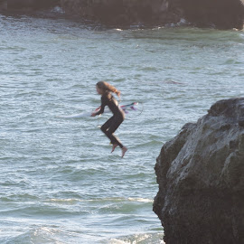 Brave Little Girl Surfer by Jan Casella - Sports & Fitness Surfing ( surfing, surfer girl, jump )