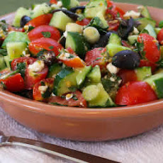 Chopped Tomato and Cucumber Salad Recipe with Mint, Feta, Lemon, and Thyme