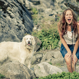 Heidi and Sasha on the rocks by Jørn Lavoll - Animals - Dogs Portraits ( nature, woman, dog, rocks, golden retriever )