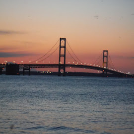 Sunset at Mackinaw by Bradley Curry - Buildings & Architecture Bridges & Suspended Structures ( lake michigan, lake huron, sunset, mackinaw city, st. ignace,  )