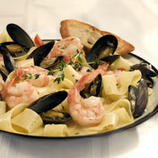 Shrimp & Mussels In Wine Sauce With Garlic Crostini