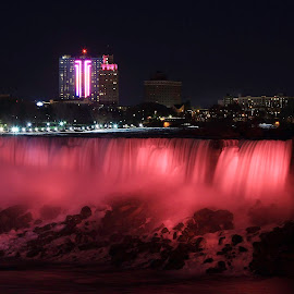 Suddenly the world is pink. by Bernice Sheppard - Landscapes Waterscapes ( breast cancer, night photos, niagara falls, pink, hope, the mood factory, mood, lighting, sassy, colored, colorful, scenic, artificial, lights, scents, senses, hot pink, confident, fun, mood factory  )