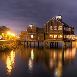 The Boathouse by Christopher Payne - Landscapes Waterscapes ( water, port, seaport, boathouse, sea, ocean, house, boat, restaurant, sky, village, bay, color, cloud, night, light )